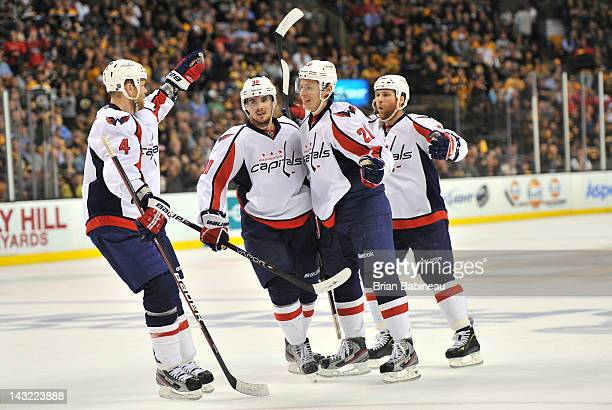 John Erskine Marcus Johansson Alexander Semin and Dennis Wideman of the Washington Capitals celebrate a goal against the Boston Bruins in Game Five...