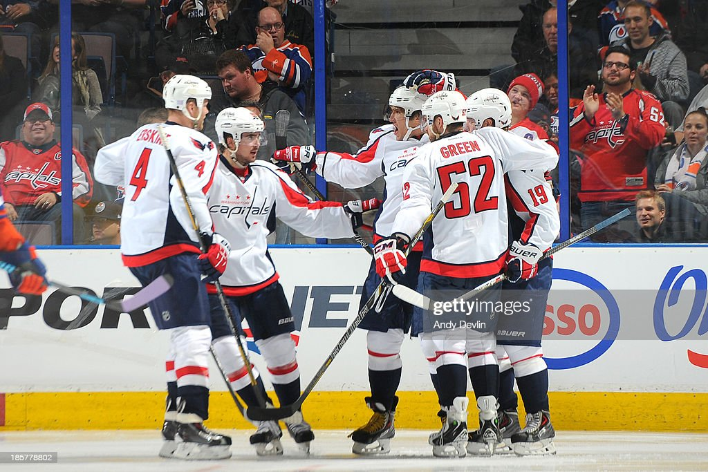 John Erskine #4, Mike Green #52 and Alex Ovechkin #8 of the Washington Capitals celebrate with team mates after a goal in a game against the Edmonton Oilers on October 24, 2013 at Rexall Place in Edmonton, Alberta, Canada.