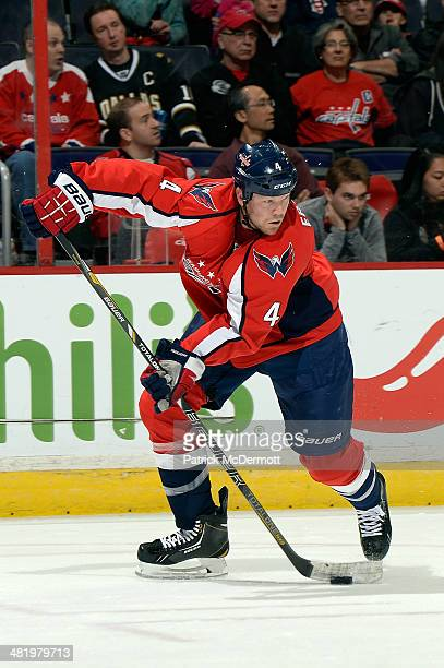 John Erskine of the Washington Capitals controls the puck in the first period during an NHL game against the Dallas Stars at Verizon Center on April...