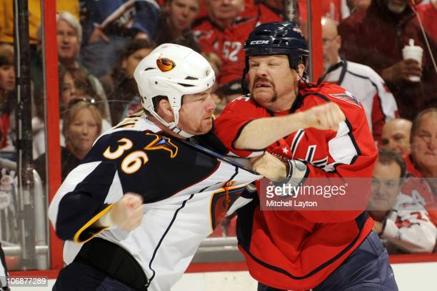 John Erskine of the Washington Capitals fights Eric Boulton of the Atlanta Thrashers during a NHL hockey game on November 14 2010 at the Verizon...