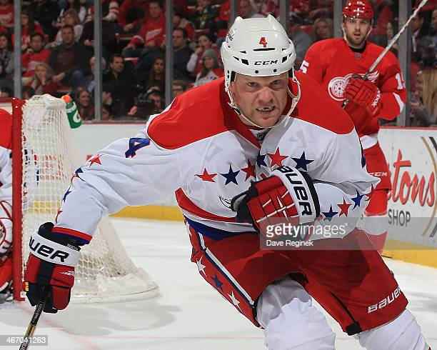John Erskine of the Washington Capitals follows the play against the Detroit Red Wings during an NHL game on January 31 2014 at Joe Louis Arena in...