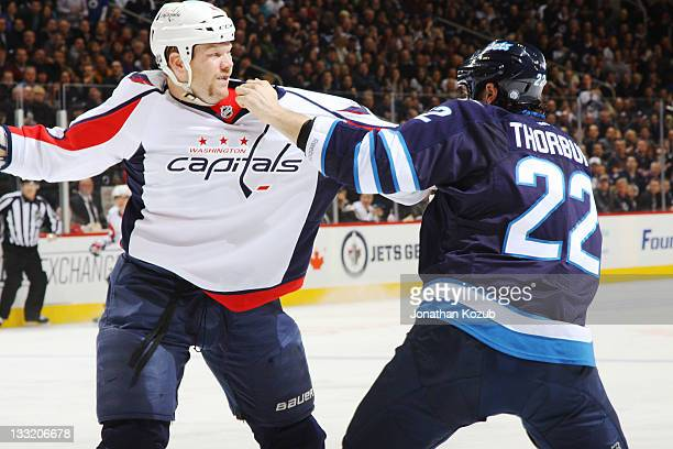 John Erskine of the Washington Capitals mixes it up with Chris Thorburn of the Winnipeg Jets in second period action at the MTS Centre on November 17...