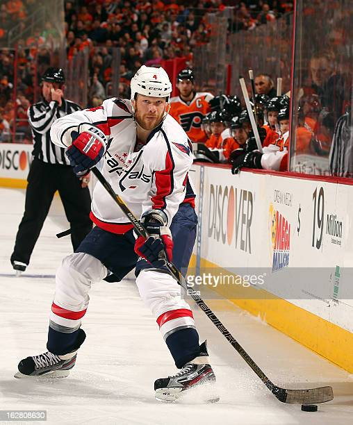 John Erskine of the Washington Capitals passes the puck in the third period against the Philadelphia Flyers on February 27 2013 at the Wells Fargo...