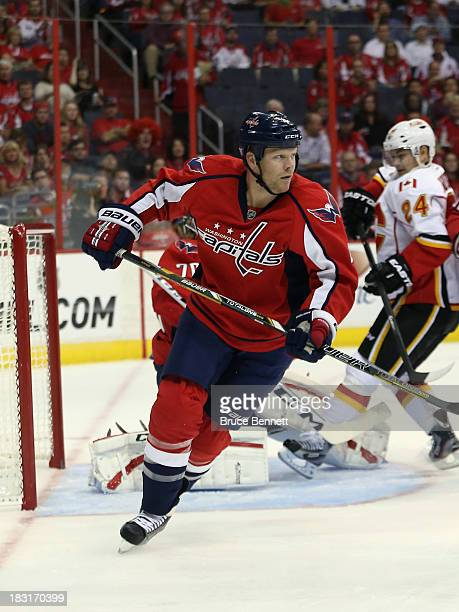 John Erskine of the Washington Capitals skates against the Calgary Flames at the Verizon Center on October 3 2013 in Washington DC The Capitals...