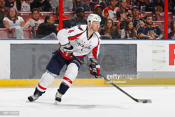 John Erskine of the Washington Capitals skates with the puck against the Florida Panthers at the BBT Center on April 6 2013 in Sunrise Florida The...