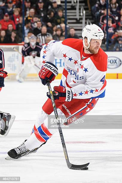 John Erskine of the Washington Capitals skates with the puck against the Columbus Blue Jackets on January 17 2014 at Nationwide Arena in Columbus Ohio