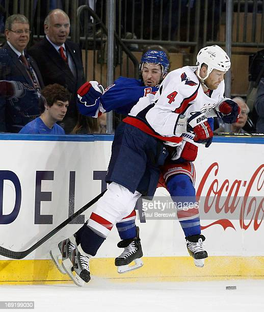 John Erskine of the Washington Capitals throws a check in Game Six of the Eastern Conference Quarterfinals against the New York Rangers during the...