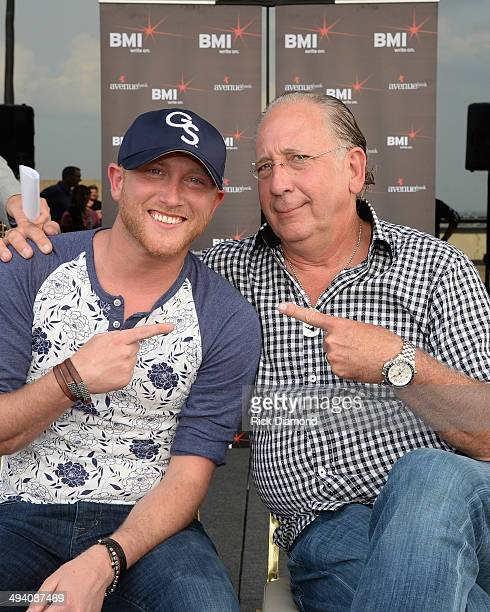 John Esposito Warner Music Nashville President/CEO congratulates Singer/Songwriter Cole Swindell on his First No1 Song Chillin' It at BMI Nashville...