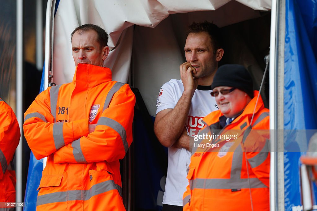 John Eustace of Derby County watches the match from the tunnel after receiving a red card during the Sky Bet Championship match between Ipswich Town and Derby County at Portman Road on January 10, 2015 in Ipswich, England.