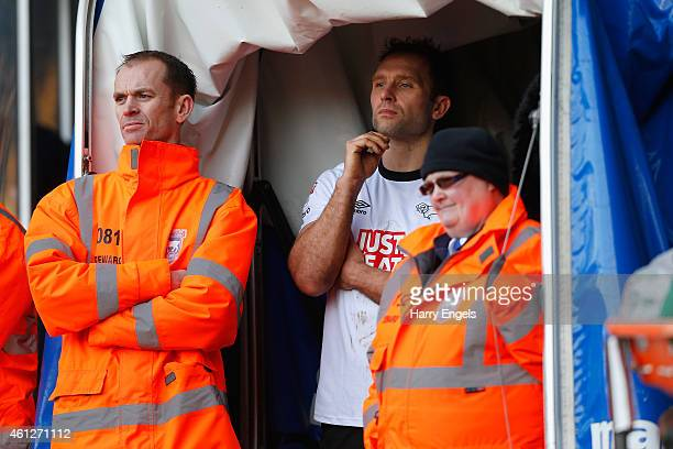 John Eustace of Derby County watches the match from the tunnel after receiving a red card during the Sky Bet Championship match between Ipswich Town...