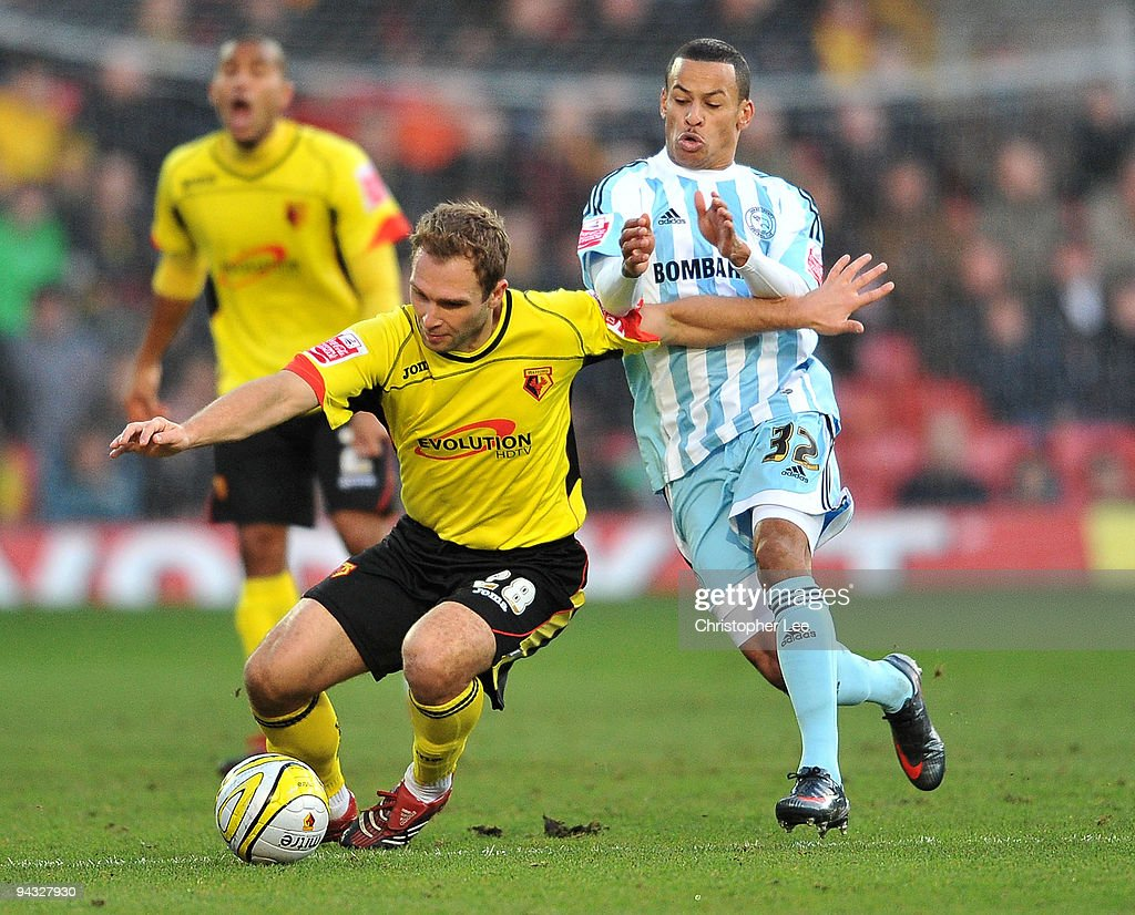 John Eustace of Watford battles with DJ Campbell of Derby during the Coca-Cola Championship match between Watford and Derby County at Vicarage Road on December 12, 2009 in Watford, England.
