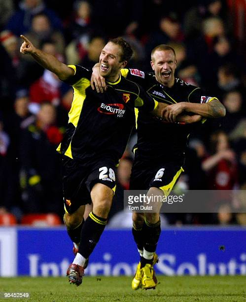 John Eustace of Watford together with Jay DeMerit celebrates scoring the equalising goal during the Coca Cola Championship match between Bristol City...