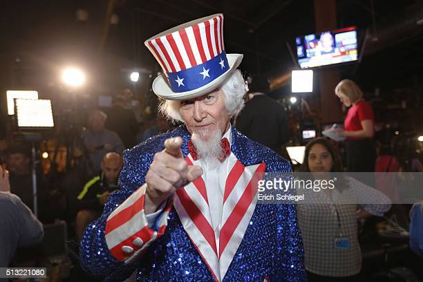 John Evans dressed as Uncle Sam of Kingwood Texas a supporter of Republican presidential candidate Sen Ted Cruz attends a Super Tuesday watch party...