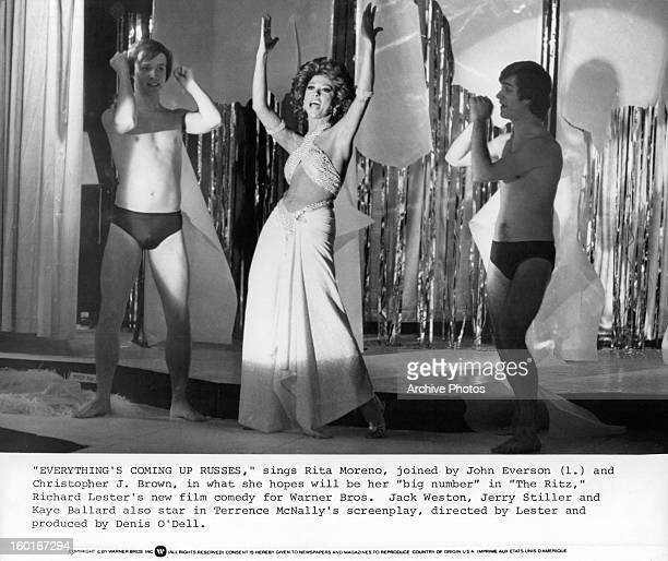 John Everson and Christopher J Brown join Rita Moreno on stage to perform big number in a scene from the film 'The Ritz', 1976.