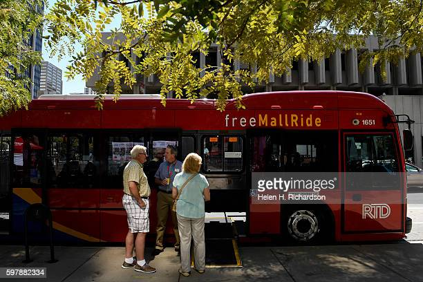John Everton left and his wife Liz right check out the new 16th Street Free MallRide bus on display at Skyline Park on the 16th street mall on August...