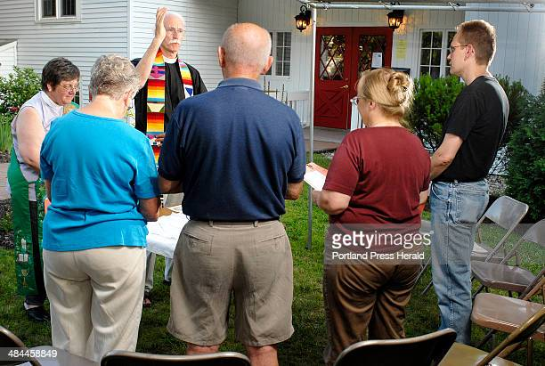 John Ewing/Staff Photographer: 20070726 -- Thursday, July 26, 2007 -- .Father David Robinson, rector at Trinity Episcopal Church in Saco, conducts an...