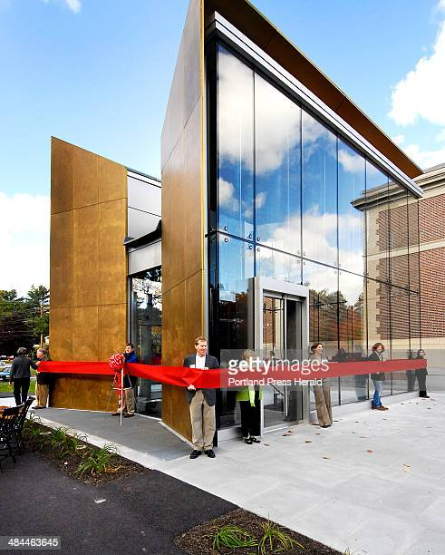 Sunday October 14 2007 Patrons of the Bowdoin College Museum of Art hold a large red ribbon encircling the museum's new building prior to a ribbon...