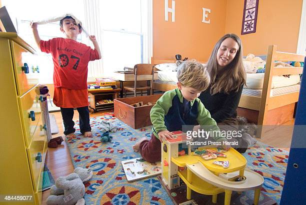 Thursday January 3 2008 Julie Falatko of South Portland enlisted the help of her sons Henry and Eli to pick up the clutter of toys in the boys'...