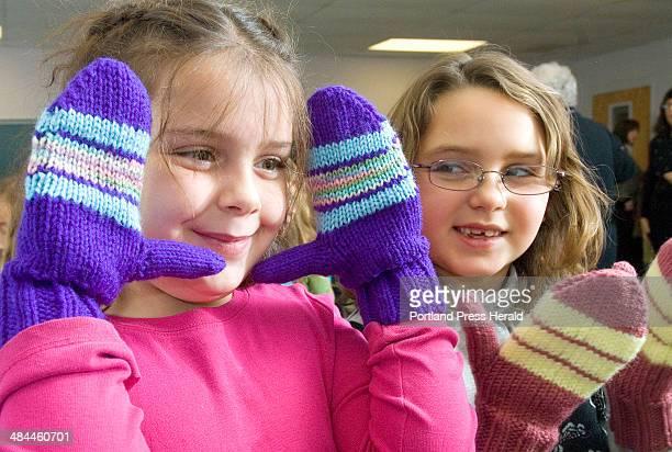 Wednesday December 12 2007 Windham Primary School first graders Brooke Keene and Gretchen Pelletier show off their new mittens to their teacher...
