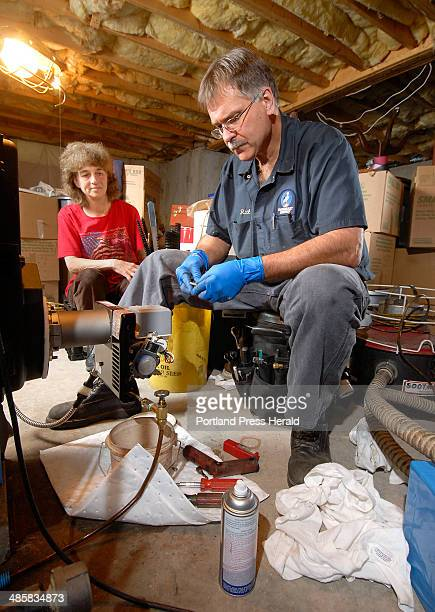 Wednesday May 28 2008 Rick Harrison a technician from Downeast Energy tunes a furnace at the home of Diana Bell in Scarborough