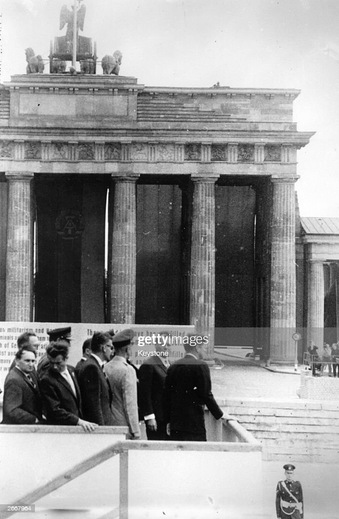 John F Kennedy (1917 - 1963) 35th President of the United States of America, with Willy Brandt, the mayor of West Berlin, at the Brandenburg Gate.