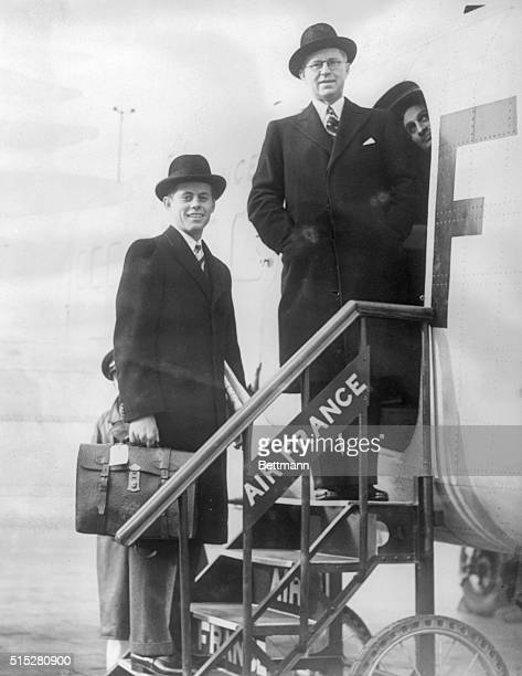 John F Kennedy and his father Joseph P Kennedy US Ambassador to Great Britain board an Air France plane at Croydon Airport John is accompanying his...