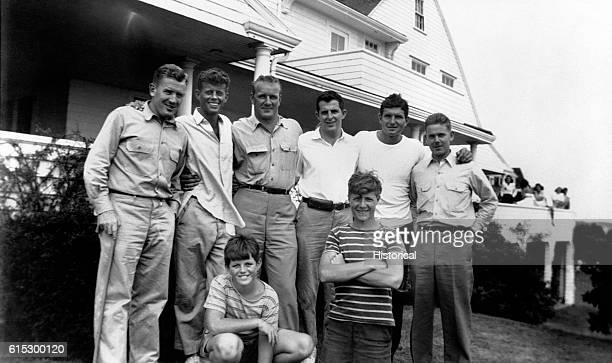 John F Kennedy and his PT 109 crew pose in front of a house at Hyannisport Massachusetts
