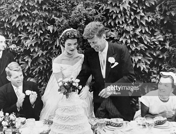 John F. Kennedy and Jacqueline Bouvier cutting their wedding cake after their marriage in Newport, Rhode Island. John Kennedy was then U.S. Senator...