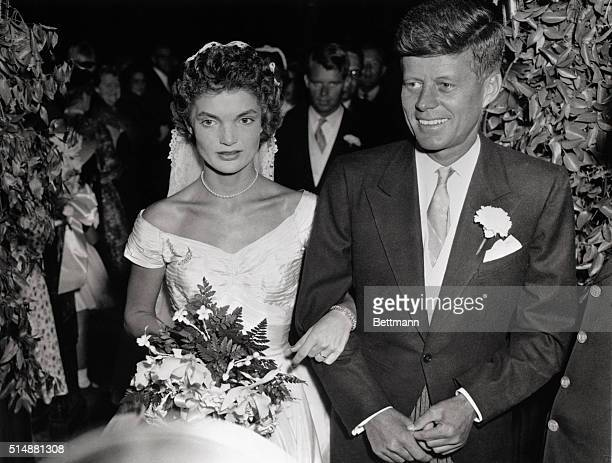 John F. Kennedy and Jacqueline Lee Bouvier wed on September 12 in St. Mary's Church in Newport, Rhode Island, USA.