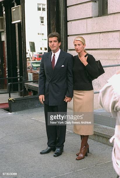 John F Kennedy Jr and bride Carolyn Bessette Kennedy stand in front of their apartment in Tribecca