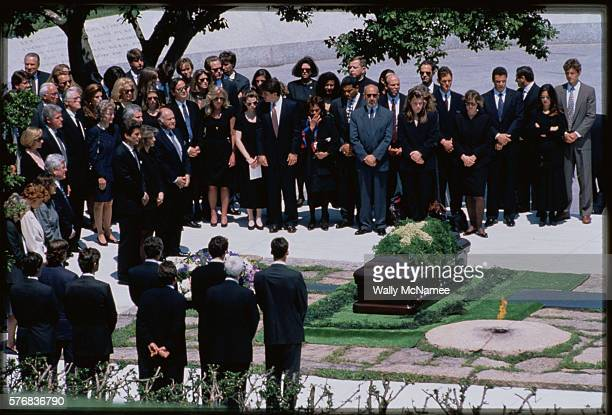 John F Kennedy Jr and Caroline Kennedy Schlossberg stand with family and friends during the funeral for their mother Jacqueline Bouvier Kennedy...