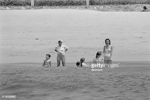 John F Kennedy Jr and his sister Caroline frolic in the Pacific Ocean with Princess Lee Radziwill and her children in front of their Mexican retreat...