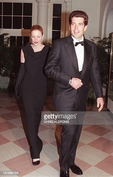 John F Kennedy Jr and his wife Carolyn Bessette Kennedy arrive at the White House 05 February for a state dinner in honor of British Prime Minister...
