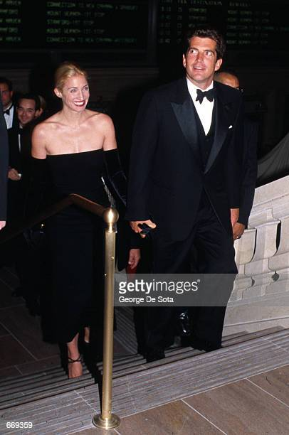 John F Kennedy Jr and wife Carolyn attend a function in honor of his mother Jacqueline Onasis October 4 1998 at Grand Central Station in New York...