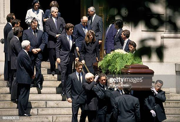 John F Kennedy Jr Caroline Kennedy Edwin Schlossberg and Maurice Tempelsman follow the coffin of Jacqueline Kennedy Onassis as it exits St Ignatius...