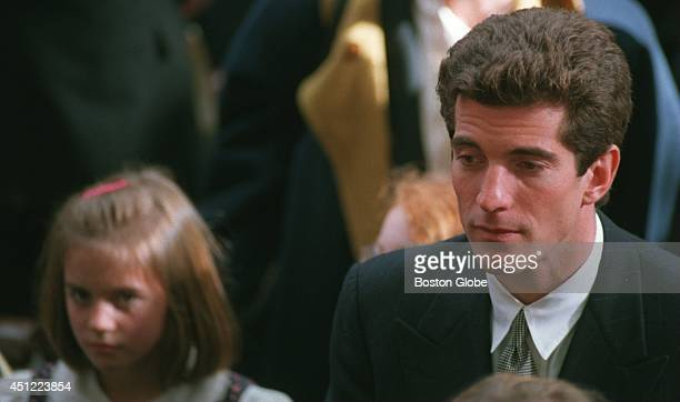 John F Kennedy Jr leaves the church after the funeral for Rose F Kennedy at St Stephen's Church