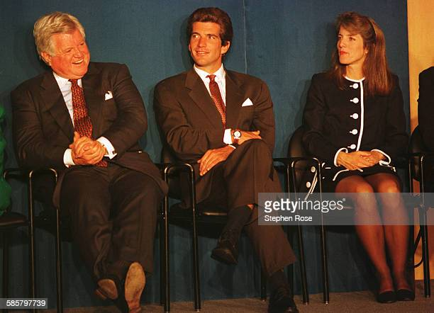 John F Kennedy Jr sits with his uncle Edward Kennedy and sister Caroline during the 1994 JFK Profile in Courage Award ceremony in Boston...