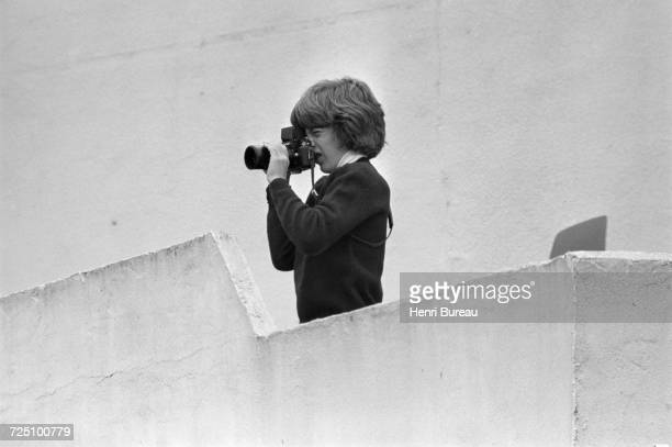 John F Kennedy Jr taking pictures with his new Nikon camera during a holiday in the Camargue region of southern France 5th November 1973 Jacqueline...