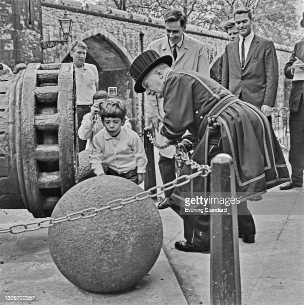 John F. Kennedy Jr. , the son of former US President John F. Kennedy, visits the Tower of London during a trip to the UK, 13th May 1965. He and his...