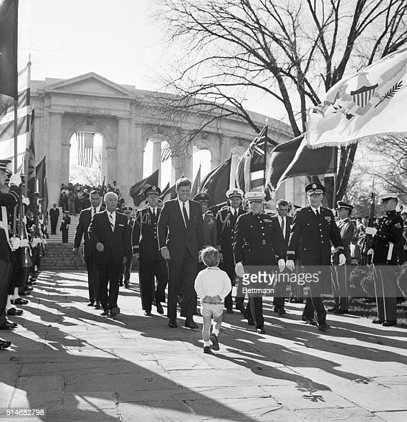 John F Kennedy Jr turns to watch his father and a group of generals at Arlington National Cemetery The President is there to honor American war dead...