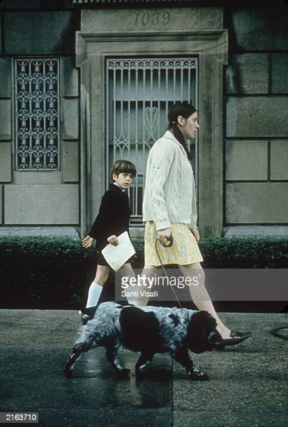 John F Kennedy Jr walks with his unidentified nanny and pet spaniel circa 1970 in New York City John F Kennedy Jr and his wife Carolyn Bessette...