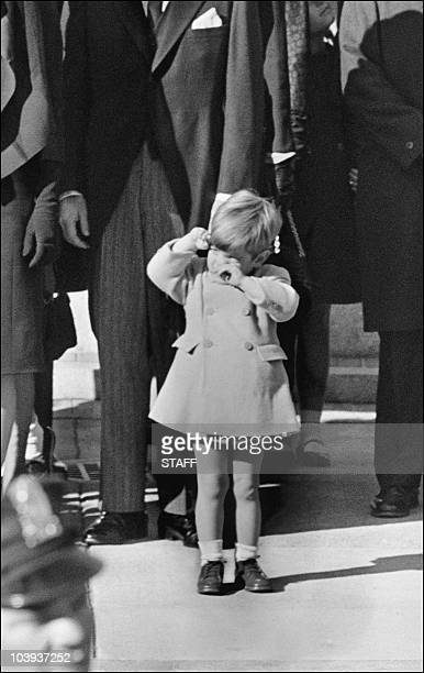 John F Kennedy Jr wipes his eyes near his mother Jacqueline Kennedy at the funeral of her father US President John F Kennedy 26 November 1963 in...