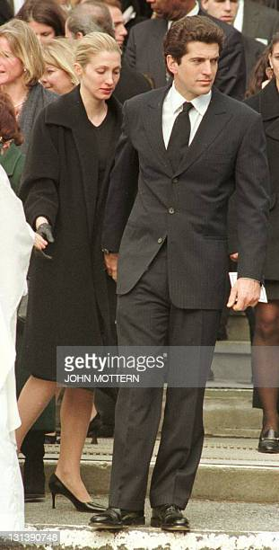 John F Kennedy Jr with his wife Caroline Kennedy leave the funeral of Michael Kennedy at Our Lady of Victory Parish in Centerville MA after services...
