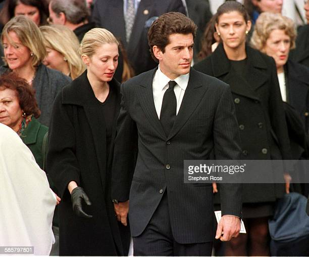 John F Kennedy Jr with his wife Carolyn after Michael Kennedy's funeral Massachusetts 1/3/98