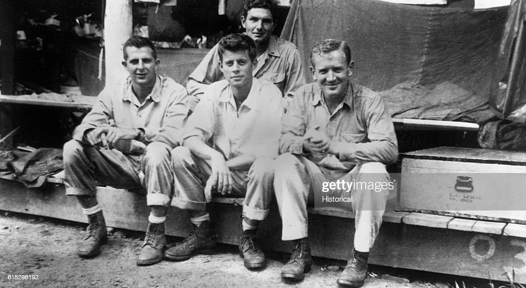 John F. Kennedy with fellow crew members in the Solomon Islands. Kennedy served in the U.S. Navy from 1941 to 1945.
