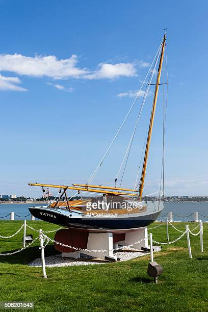 """john f. kennedy's sailing boat """"victura"""" at jfk presidential library - john f. kennedy library stock photos and pictures"""