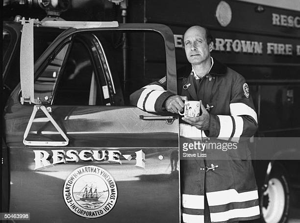 John Farrar in fireman's jacket standing w a rescue truck at Edgartown fire station he was the head of search and rescue for the the volunteer fire...