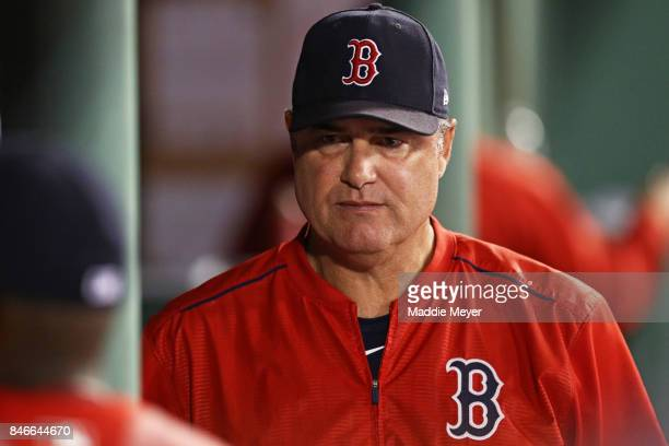 John Farrell manager of the Boston Red Sox looks on from the dugout during the first inning against the Oakland Athletics at Fenway Park on September...