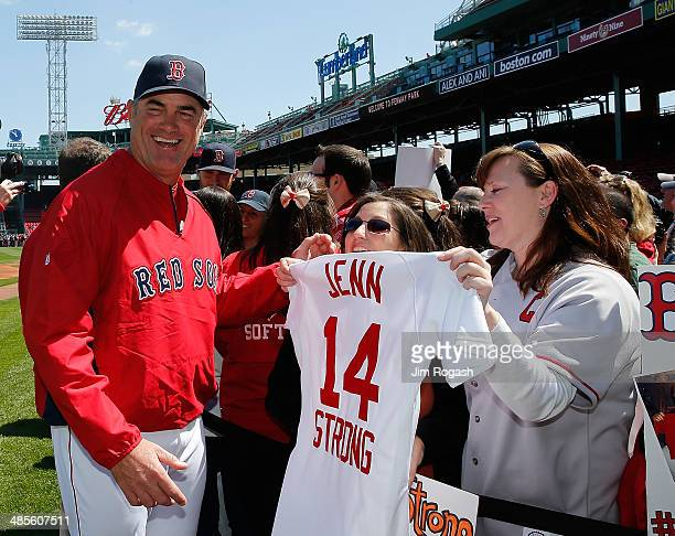 John Farrell of the Boston Red Sox interacts with a fan on Fan Photo Day before a game against the Baltimore Orioles at Fenway Park on April 19 2014...