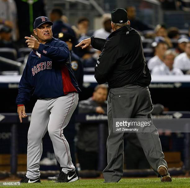 John Farrell of the Boston Red Sox is ejected by umpire Bob Davidson arguing a call settled by instant replay during a game against the New York...